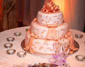 pic of three tier  - Three tiered wedding cake and champagne glasses on a table - JPG