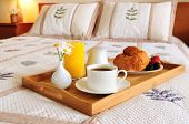 pic of continental food  - Tray with breakfast on a bed in a hotel room - JPG