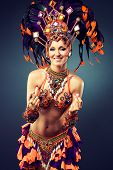 foto of belly-dance  - A dancing girl in the carnival costume. 