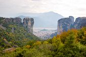 stock photo of trinity  - The view on the city of Kalambaka and the mountains of Meteora with the monastery of Holy Trinity on the top of the rock Greece - JPG