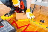 stock photo of hammer drill  - Male Worker laminate - JPG