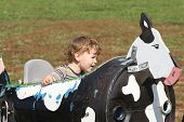 picture of hayride  - Child having fun on a farm ride - JPG