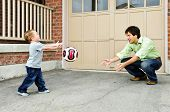 image of bounce house  - Father teaching son to play soccer on driveway - JPG