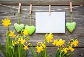 image of clotheslines  - Message and hearts on the clothesline against wooden background - JPG