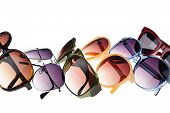 picture of protective eyewear  - Different styles of tinted sunglasses on white background - JPG