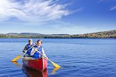 stock photo of canoe boat man  - Father and daughter canoeing on Lake of Two Rivers - JPG