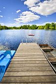 foto of dock a lake  - Wooden dock on beautiful summer lake in Ontario Canada - JPG