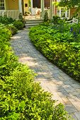 stock photo of paving stone  - Paved stone path in lush green home garden - JPG