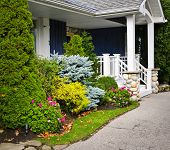 picture of entryway  - Front entrance of house with garden and porch - JPG