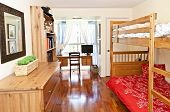 stock photo of bunk-bed  - Student bedroom with hardwood floor and bunk beds  - JPG