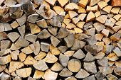 Background of chopped and split firewood logs stacked