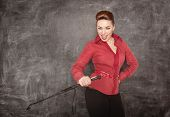 stock photo of woman red blouse  - Beautiful fashion woman in the red blouse with whip in her hand - JPG