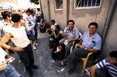 TIRANA, ALBANIA, 09 MARCH 1996 - Money changers in Tirana, Albania, wait for customers in an open ai