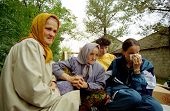 VRANIC, KOSOVO, 09 OCTOBER 1998 --- Sabria Shehu, 65, left, along with her neighbors return, to thei