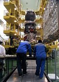 BAIKONUR COSMODROME - OCTOBER 30: Russian engineers go over blueprints for the Progress M1 spacecraf