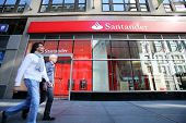 NEW YORK CITY - OCT 20 2013: Pedestrians walk past a branch of Santander Bank in Manhattan on Sunday