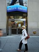 NEW YORK CITY - OCT 20 2013: Pedetrians walk past a Citibank SA retail bank branch in Manhattan on S