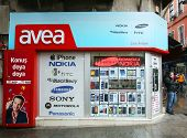 KADIKOY, TURKEY - SUNDAY, MARCH 9, 2014: Pedestrians walk past an Avea mobile telephone retail outle