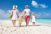 stock photo of children beach  - Happy beautiful family on a tropical beach vacation - JPG