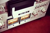 picture of analogy  - Analog Stereo Open Reel Tape Deck Recorder VU Meter Device Closeup - JPG