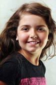 picture of long tongue  - adorable child with long floating hair sticking her tongue out - JPG