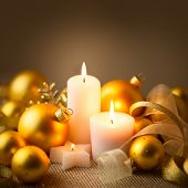 pic of weihnachten  - Christmas Golden Candles Background with Baubles and Ribbons  - JPG