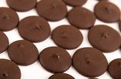 stock photo of bonbon  - close up of rich dark milk homemade chocolate bonbons selective focus isolated on white - JPG
