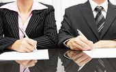pic of minister  - businesswoman and businessman signing contract after negotiations - JPG