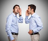 pic of personality  - Man talking to a clone of himself - JPG