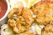 picture of crab-cakes  - new england style crab cakes with seafood sauce and lemon wedges - JPG
