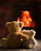 pic of teddy  - Two teddy bears sitting by the fire - JPG