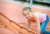 image of playground school  - cute beautiful smiling little girl on a playground - JPG