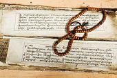 pic of sanskrit  - Tibetian wood block printed text and prayer beads - JPG