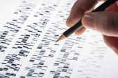 foto of scientist  - Scientists examined DNA gel that is used in genetics medicine biology pharma research and forensics - JPG