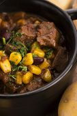 stock photo of stew pot  - Tasty winter traditional hot pot stew with meat and vegetables - JPG