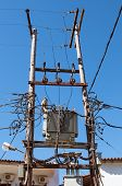 pic of electricity pylon  - Dangerous looking wooden electricity pylon overloaded with cables - JPG