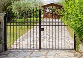 picture of front-entry  - Closed steel security gates protecting a house