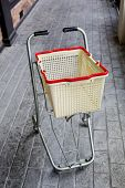 image of grocery cart  - shopping grocery cart on cement floor background - JPG