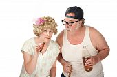 stock photo of hillbilly  - Suspicious couple with cigars and a 40 oz beer - JPG