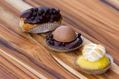 picture of panna  - serving of three small desserts on a table focus on the chocolate panna cotta - JPG
