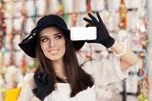 image of diva  - Portrait of a young elegant girl with shopping bags and Smartphone - JPG