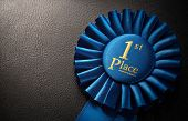 pic of rosettes  - First place award rosette over dark background with copy space - JPG