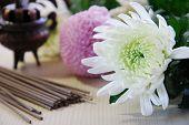 stock photo of religious  - stick incense with flowers for religious event - JPG