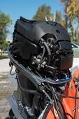 stock photo of outboard engine  - Close up image of an outboard motor with cowling off - JPG