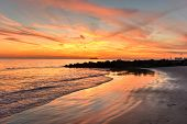pic of vivid  - Coney Island Beach at sunset with a vivid dramatic sky - JPG