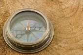 picture of girth  - Close up  old Compass on  wood  background - JPG
