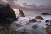 foto of tide  - Soft and subtle hues of dawn and a rising tide around the rocks at Lighthouse Beach Port Macquarie - JPG