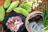picture of bitters  - Vietnamese food soup of bitter melon stuffed with ground meat a nutrition popular dish in Vietnam meal bitter gourd rich vitamin can anti diabetes season with spring onion peziza - JPG