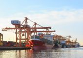 picture of container ship  - commercial ship loading container in shipping port image use for import export nautical vessel transport and industry logistic  - JPG