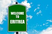 picture of eritrea  - Green road sign with greeting message WELCOME TO ERITREA isolated over clear blue sky background with available copy space - JPG